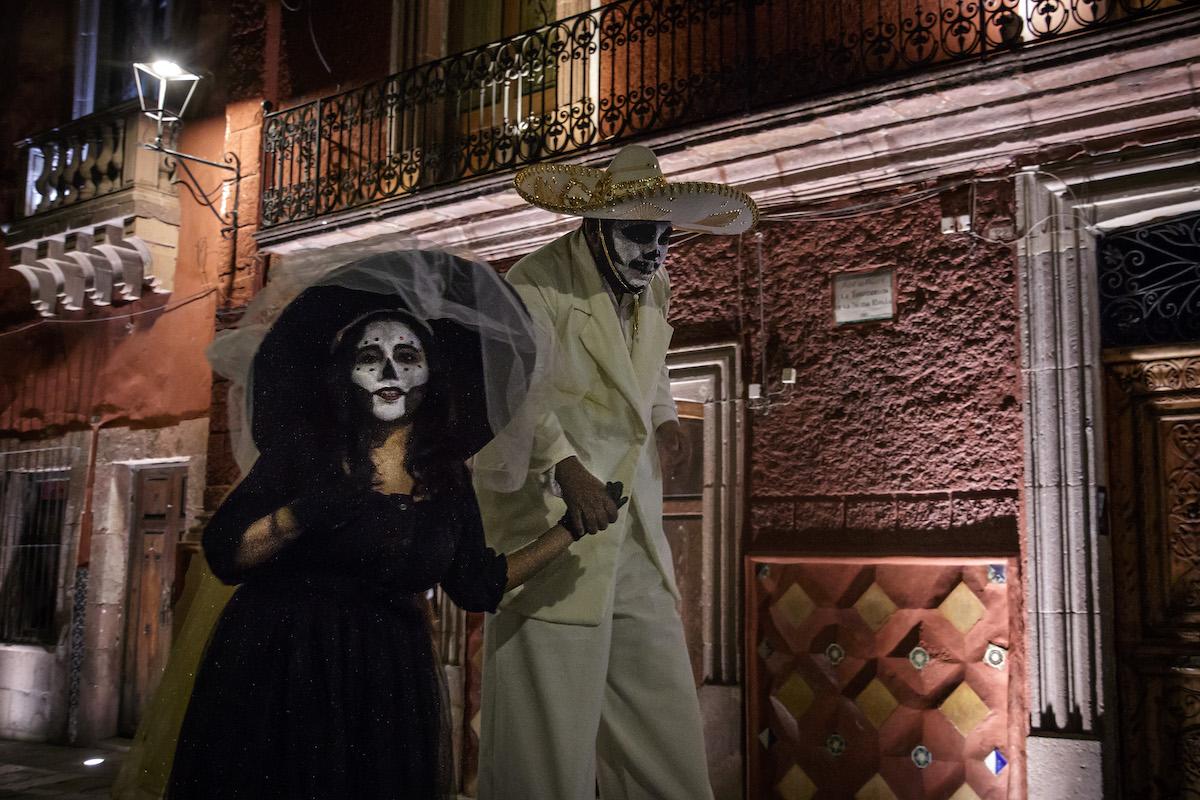 people dressed as decorated skeletons
