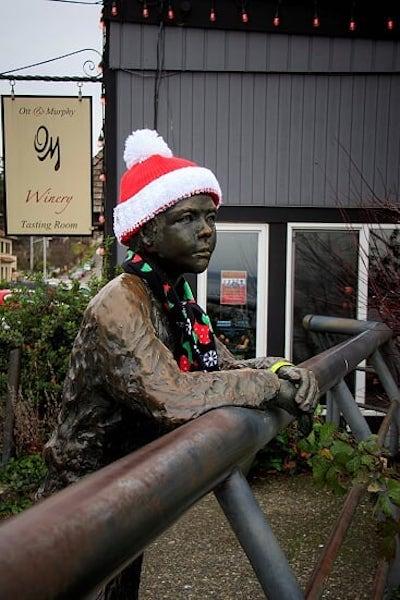 bronze boy with santa hat