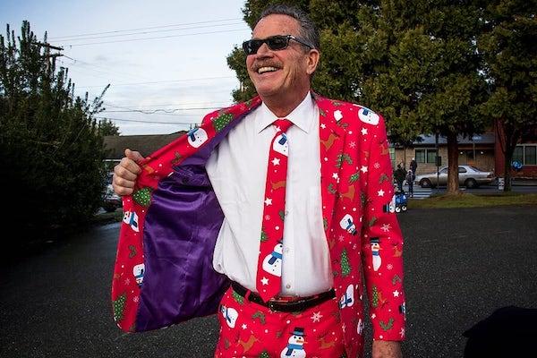 Man with santa-printed suit.