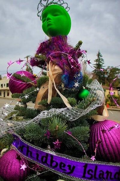 Green face atop a ballet themed tree
