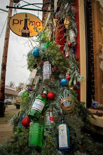 wine and alcohol bottles decorate a tree