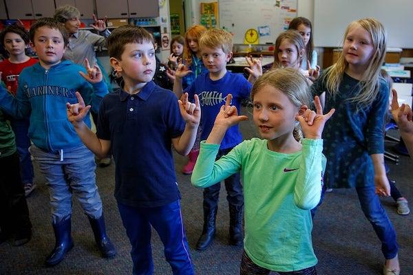 Students give shaka sign