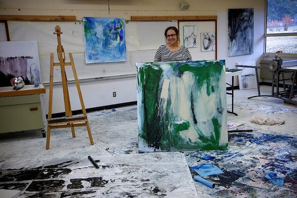 Woman holds abstract painting