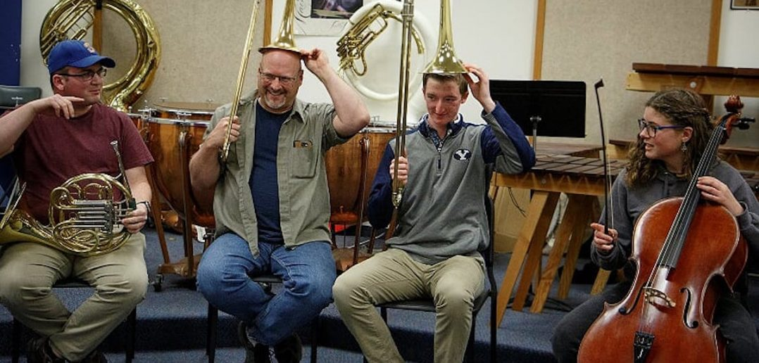 Man with trombone on his head